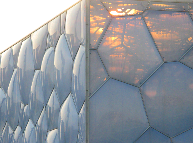 "A view over the Olympics' Aquatics Center or the ""water cube"", at sunset. Architect Chris Bosse, Germany"