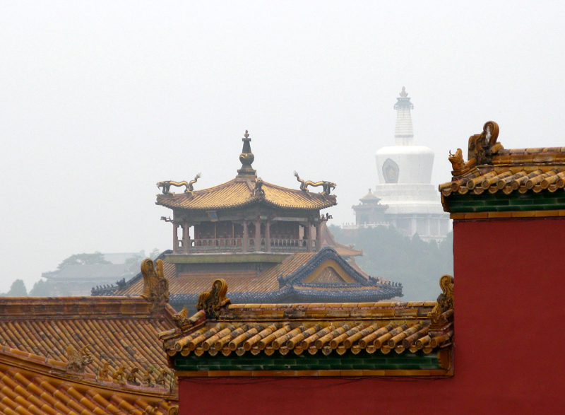 Roofs with glazed yellow tiles are the sign of imperial power's residences, when people's houses are grey with grey roofs