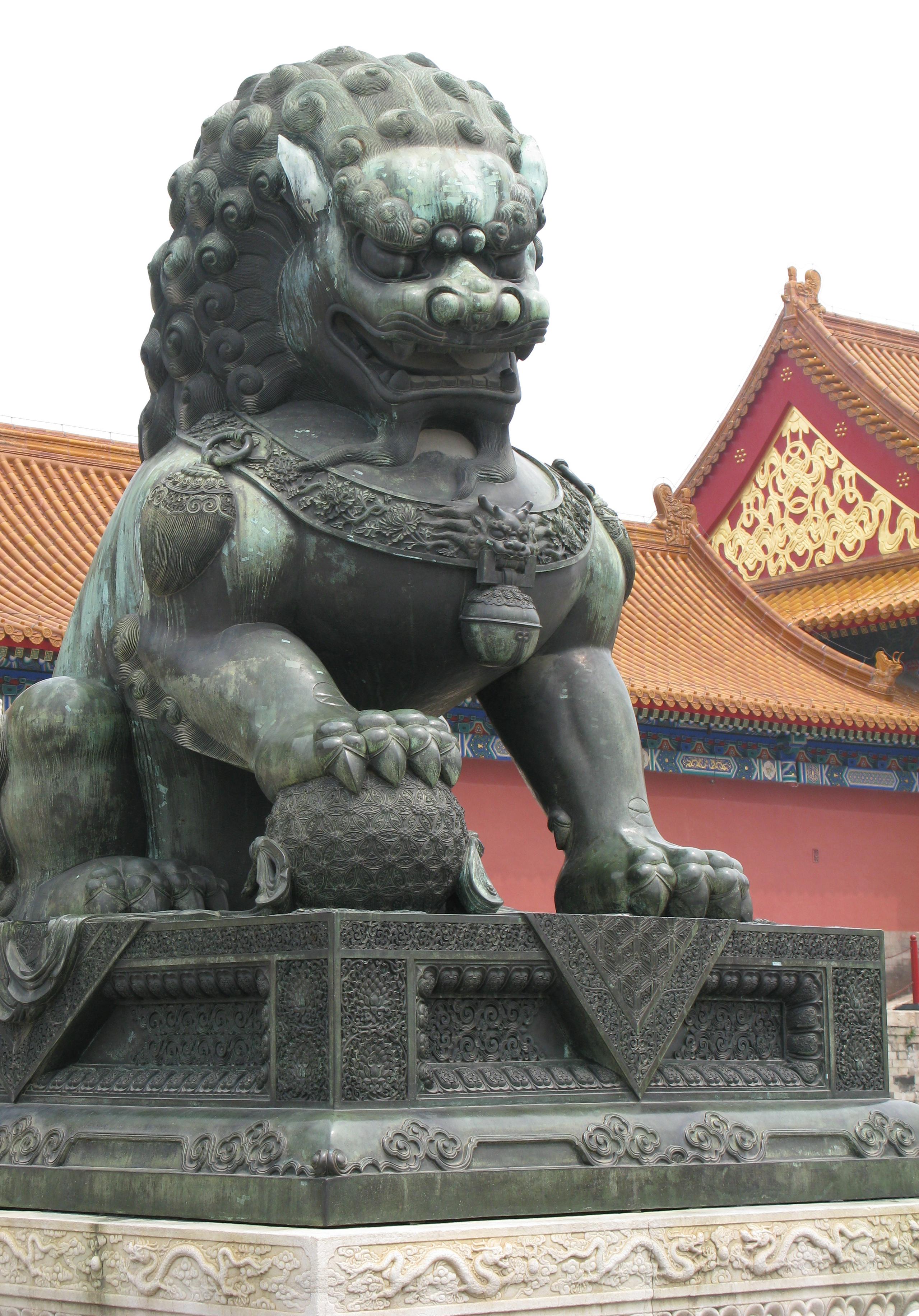 A lion, a leg on a globe, symbol of power