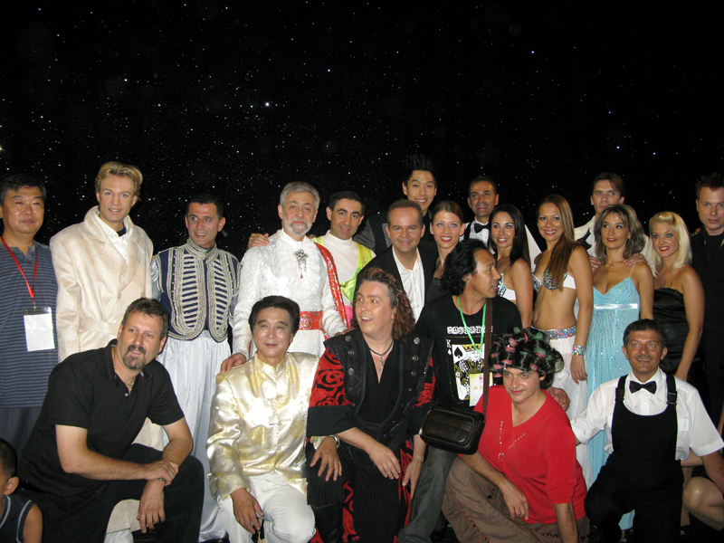 "Just after the 24th FISM World Magic Congress, also in Beijing : ""Supreme Magic"" show for the Chinese audiences with (from l.to r.) standing : Chinese stage manager, Peter MARVEY, JORGOS, Omar PASHA, Louis, TOPAS, Eun-Gyeol LEE, ROXANE, 1 of I.Ma.Gi.A, 2 P. Marvey's assistants, Vitaliy & Yelena - DOUBLE FANTASY, YUNKE & partner. In a squatting position : Mike MILLER, Chinese M.C., Jeff Mc BRIDE, a magic fan, 2 of I.Ma.Gi.A"
