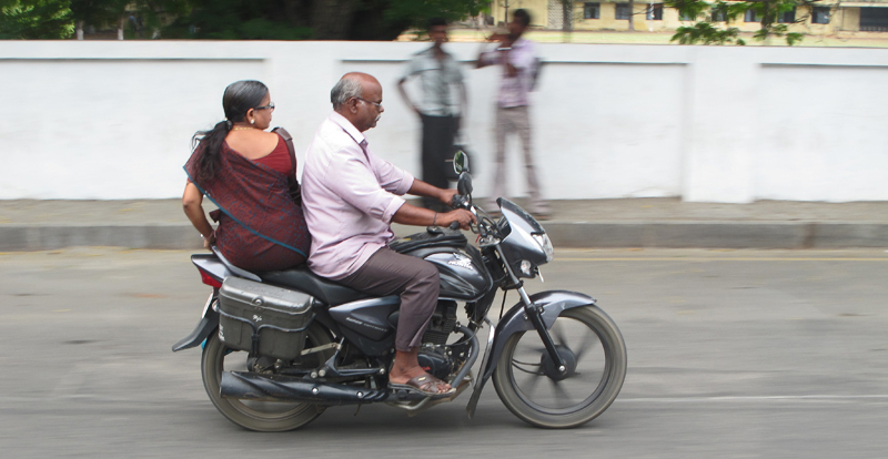 Motorcycle couple in town